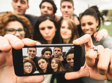 Image showing a group of millennials taking a selfie