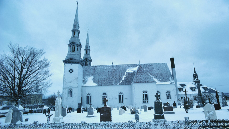 Image of a church and cemetery under snow