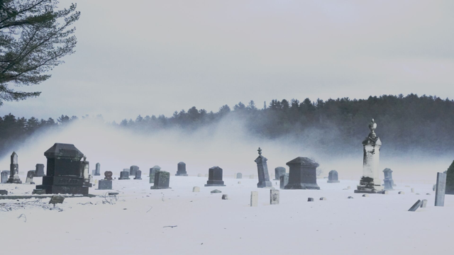 Image of a cemetery under snow